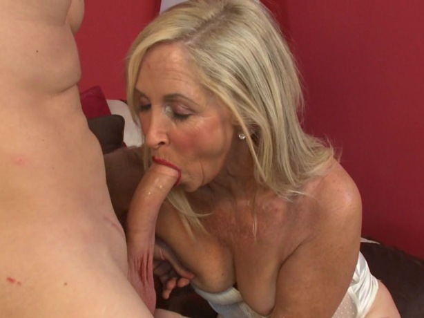 Horny Milfs blonde woman shows off her large fake breasts before inserting a ...